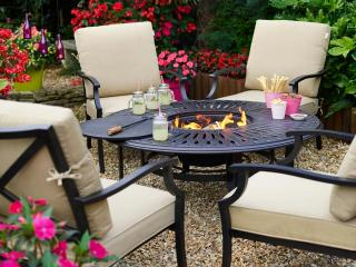 A versatile cast aluminium set finished in bronze with a central fire pit.
