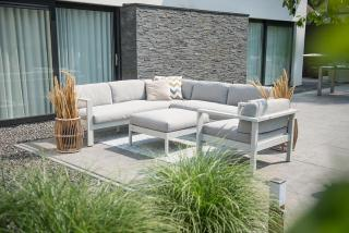 This modular set has an aluminium frame with a sea shell finish & grey all weather cushions.