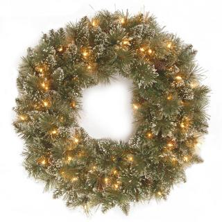 This battery operated artificial Christmas wreath can be used indoors or out & can be controlled by the timer.
