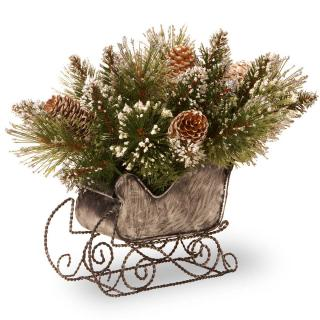 This artificial Christmas sleigh is filled with glittering snowy branches & cones.