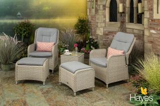This attractive set for two offers endless comfort with reclining armchairs & footstools for putting your feet up.