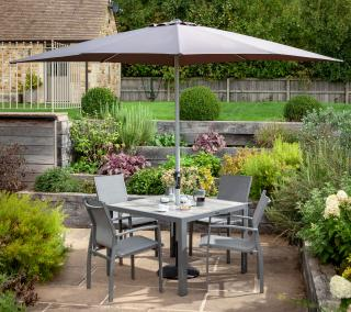 A contemporary set for four which is maintenance free with a multi-tone grey ceramic topped square garden table & texteline chairs topped off by a complementing parasol & base.