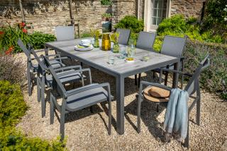 A rectangular dining set for eight with a multi-tone grey ceramic topped garden table, texteline chairs, parasol & base in contemporary shades of platinum & dusk.