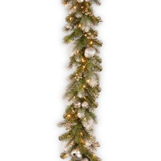 This artificial Christmas garland is a glittering mix of silver pomegranates & champagne berries with frosty white tipped branches & 100 battery operated LED lights.