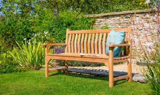 This is a pre-built ready assembled Teak Bench with Curved Back and Flat Arms. Comes with a free cushion.