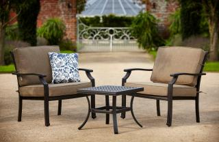 A pair of 'Chill Out' Chairs with Weatherready® cushions & matching coffee table finished in a choice of bronze or riven black.