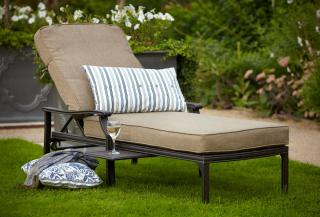 A cast aluminium adjustable garden sun lounger in Bronze with a deep Weatherready® cushion in biscuit.