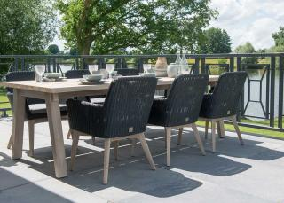 A contemporary rectangular dining set for six with dark woven chairs & a choice of teak or aluminium legs.