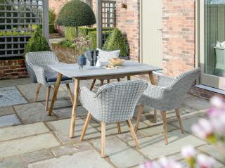 An attractive mixed media dining set for four with Acacia legs, woven chairs & poly-cement table top. (Image shows square set).
