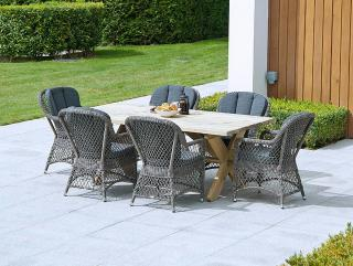 This mixed materials rectangular set features open weave armchairs with a 1.9m Pine Farmers table.
