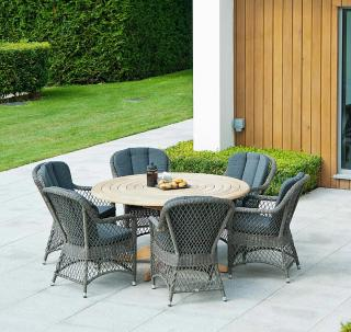 This mixed materials set features open weave armchairs with a 1.45m Roble hardwood table.