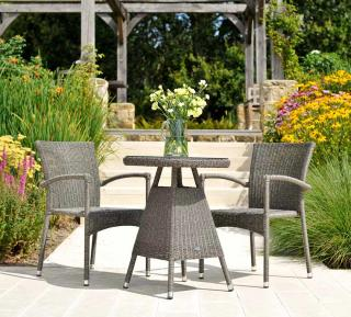 This small low maintenance set features resin weave stacking armchairs with a 0.6m woven table.