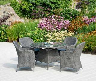 This low maintenance set features resin weave dining armchairs with a 1.2m woven table.