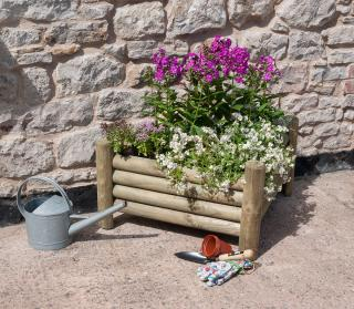 The space saving Norbury Corner Planter is ideal for gardens with limited space.