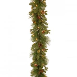 Our artificial Eastwood Spruce Christmas garland is simply decorated with cones & lights.