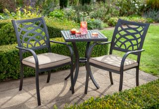 A cast aluminium set which is ideal for a small space, it comes finished in Bronze with Amber Weatherready® seat pads.