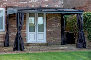 This rectangular gazebo has an aluminium frame with a retractable polycarbonate roof to make the most of the British weather.