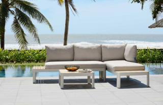 This modular aluminium sofa set has in-built teak tables on either end & comes with premium-grade olefin cushions.
