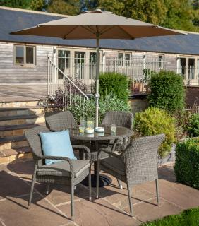 A round 1.05m resin weave dining set for four with a parasol & base in contemporary slate & stone tones.