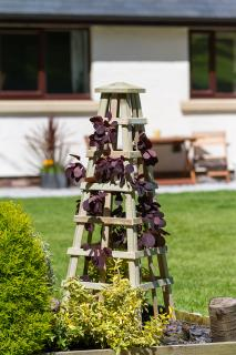 The Scafell Obelisk will act as a solid feature with or without plants.