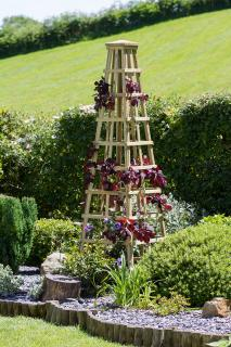 The Snowdon Obelisk will act as a solid feature with or without plants.