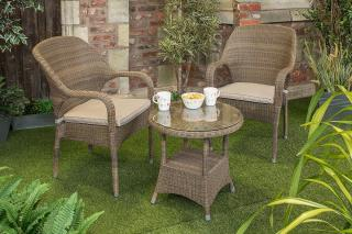 A weatherproof Hularo Weave tea for two set in Polyloom Taupe with all weather cushions.