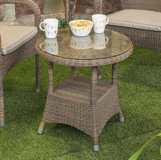 A small round Hularo Weave bistro table in Polyloom Taupe with a glass top.