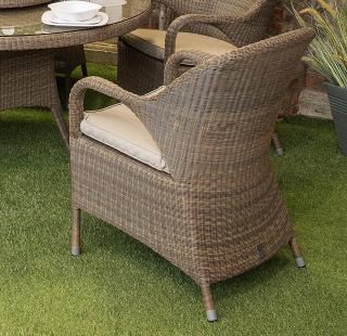 A curvy Hularo Weave dining chair in Polyloom Taupe with all weather cushion in London Taupe.