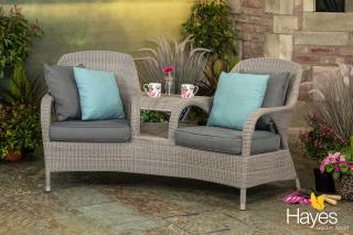 An outstanding Hularo Weave companion set in Polyloom Pebble with all weather cushions in anthracite grey.
