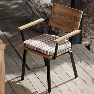 The Titan Armchair is part of a new teak that uses the wood knots and grain pattern to achieve a beautiful and unique set.