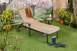 A cast aluminium garden lounger finished in bronze with a deep Weatherready® cushion in Desert.