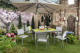 This rectangular aluminium garden set comes with a glass top table & easily seats 6 (image only shows four chairs).
