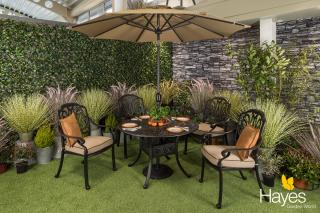 A roomy cast aluminium garden set finished in bronze with Weatherready® cushions in fawn.
