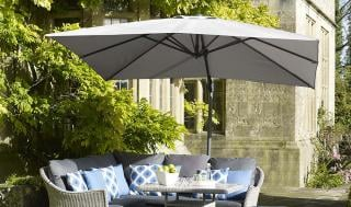 The Lichfield 2.7m Square Parasol from Bramblecrest has an aluminium side post parasol with crank handle mechanism. Available in Grey and Sand.