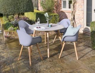 An attractive mixed media dining set for four with Acacia legs, polypropylene chairs & poly-cement table top.